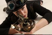2017 08 CLAUDIA STEAMPUNK LAYING AIMING CROSSBOW PISTOL 10