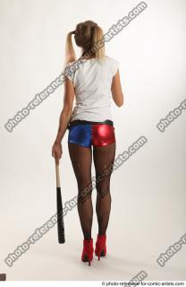 07 2018 01 NIKOL HARLEY STANDING POSE WITH BASEBALL BAT AND GUN