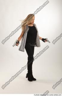 07 2018 01 NIKOL ACTION STANDING POSE WITH GUNS