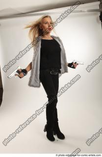 14 2018 01 NIKOL ACTION STANDING POSE WITH GUNS