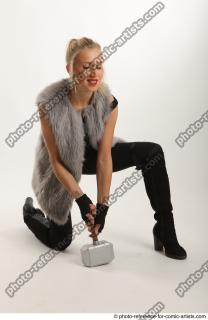 03 2018 01 NIKOL  KNEELING POSE WITH HAMMER