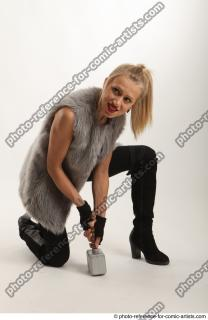 07 2018 01 NIKOL  KNEELING POSE WITH HAMMER