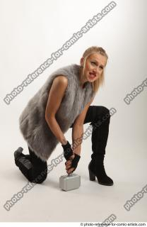 08 2018 01 NIKOL  KNEELING POSE WITH HAMMER