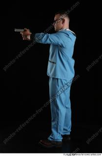 03 2018 01 MICHAL AGENT STANDING POSE WITH GUN