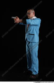 02 2018 01 MICHAL AGENT STANDING POSE WITH GUN