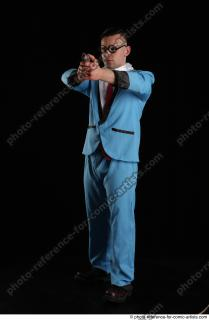 01 2018 01 MICHAL AGENT STANDING POSE WITH GUN