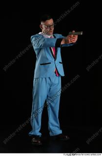 07 2018 01 MICHAL AGENT STANDING POSE WITH GUN
