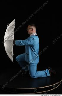 01 2018 01 MICHAL KNEELING POSE WITH UMBRELLA