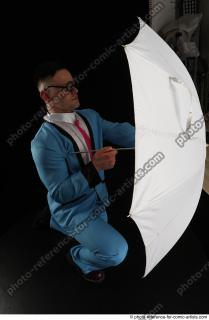 09 2018 01 MICHAL KNEELING POSE WITH UMBRELLA