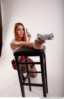 26 2018 01 TINA KNEELING POSE WITH GUNS