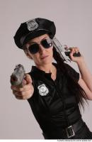 31 2019 01 NIKITA POLICEWOMAN WITH GUNS