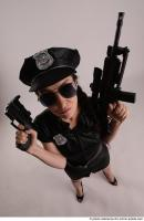 27 2019 01 NIKITA POLICEWOMAN WITH TWO GUNS