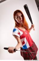 29 2019 01 KRISTINA STADING POSE WITH DAGGER AND BASEBALL BAT