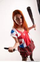 27 2019 01 KRISTINA STADING POSE WITH DAGGER AND BASEBALL BAT