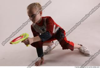 05 2019 01 DENISA SITTING POSE WITH GUN