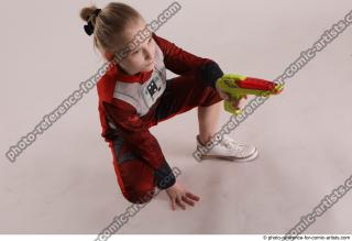 17 2019 01 DENISA SITTING POSE WITH GUN
