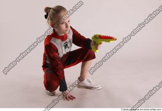 19 2019 01 DENISA SITTING POSE WITH GUN