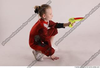 15 2019 01 DENISA SITTING POSE WITH GUN