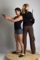 2021 01 OXANA AND XENIA STANDING POSE WITH GUNS (1)