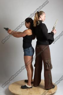2021 01 OXANA AND XENIA STANDING POSE WITH GUNS (3)