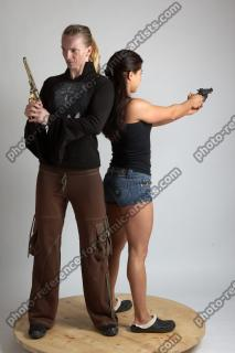 2021 01 OXANA AND XENIA STANDING POSE WITH GUNS (6)