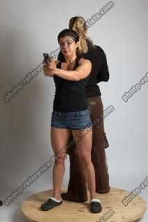 2021 01 OXANA AND XENIA STANDING POSE WITH GUNS (9)
