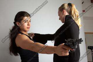 2021 01 OXANA AND XENIA STANDING POSE WITH GUNS 2 (12)
