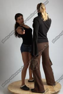 2021 01 OXANA AND XENIA STANDING POSE WITH GUNS 2 (2)