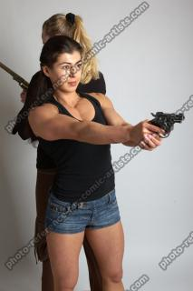 OXANA AND XENIA STANDING POSE WITH GUNS 3 (1)
