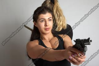 OXANA AND XENIA STANDING POSE WITH GUNS 3 (2)