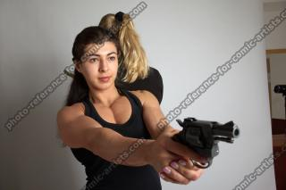 OXANA AND XENIA STANDING POSE WITH GUNS 3 (3)