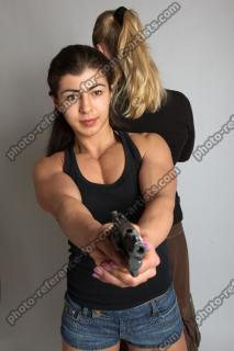 OXANA AND XENIA STANDING POSE WITH GUNS 3 (4)