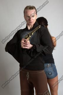 OXANA AND XENIA STANDING POSE WITH GUNS 3 (9)